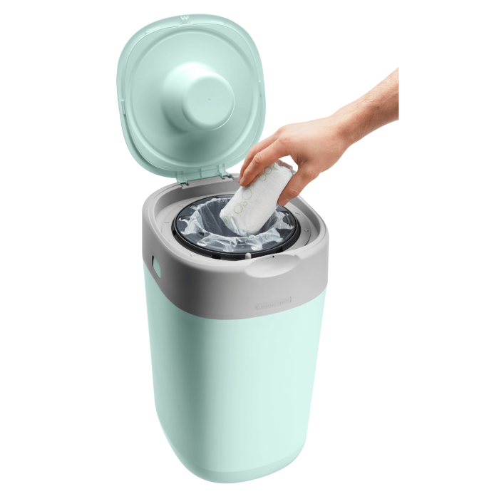 inserting-nappy-into-green-twist-and-click-bin